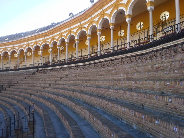 Patron seating are in Plaza de Toros in Seville Spain