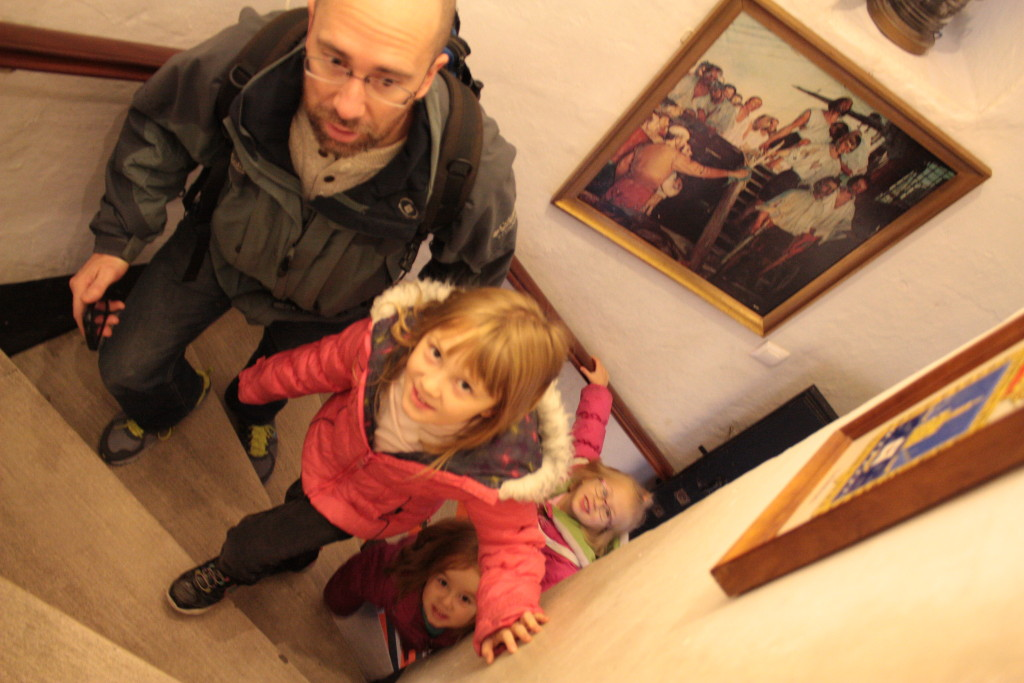 My kids on the stairs inside the Torre del Oro in Seville Spain