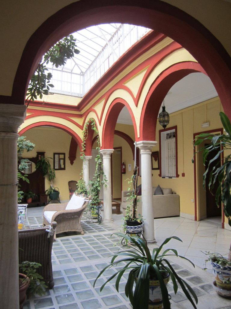 Atrium on the second level of Hostal Sierpes in Seville